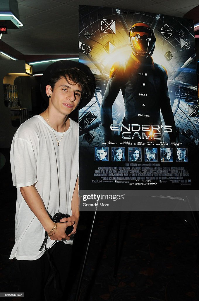 Actor Moises Arias poses during the 'Ender's Game' special screening hosted by Kennedy Space Center and Clear Channel at Regal Winter Park on October...