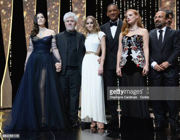 Actor Monica Bellucci President of the jury Pedro Almodovar actor LilyRose Depp and jury members Will Smith Jessica Chastain and Asghar Farhadi...
