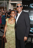Actor Morgan Freeman and his granddaughter attend the premiere of 'The Dark Knight' at AMC Loews Lincoln Center on July 14 2008 in New York City