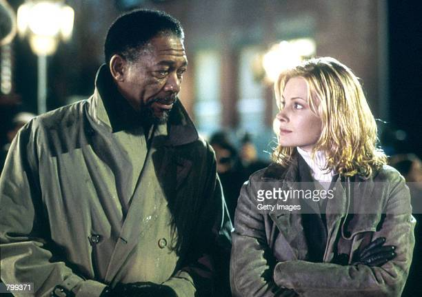Actor Morgan Freeman performs as Alex Cross and actress Monica Potter performs as Jezzie Flannigan act in a scene from 'Along Came A Spider'