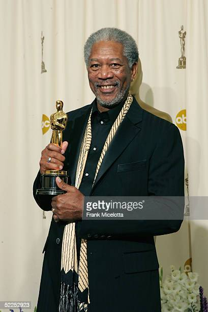 Actor Morgan Freeman poses with his 'Best Actor in a Supporting Role' award for his performance in 'Million Dollar Baby' backstage during the 77th...