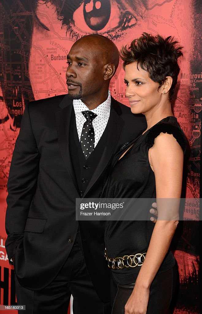 Actor Morris Chestnut and actress Halle Berry arrive at the premiere Of Tri Star Pictures' 'The Call' at ArcLight Cinemas on March 5, 2013 in Hollywood, California.