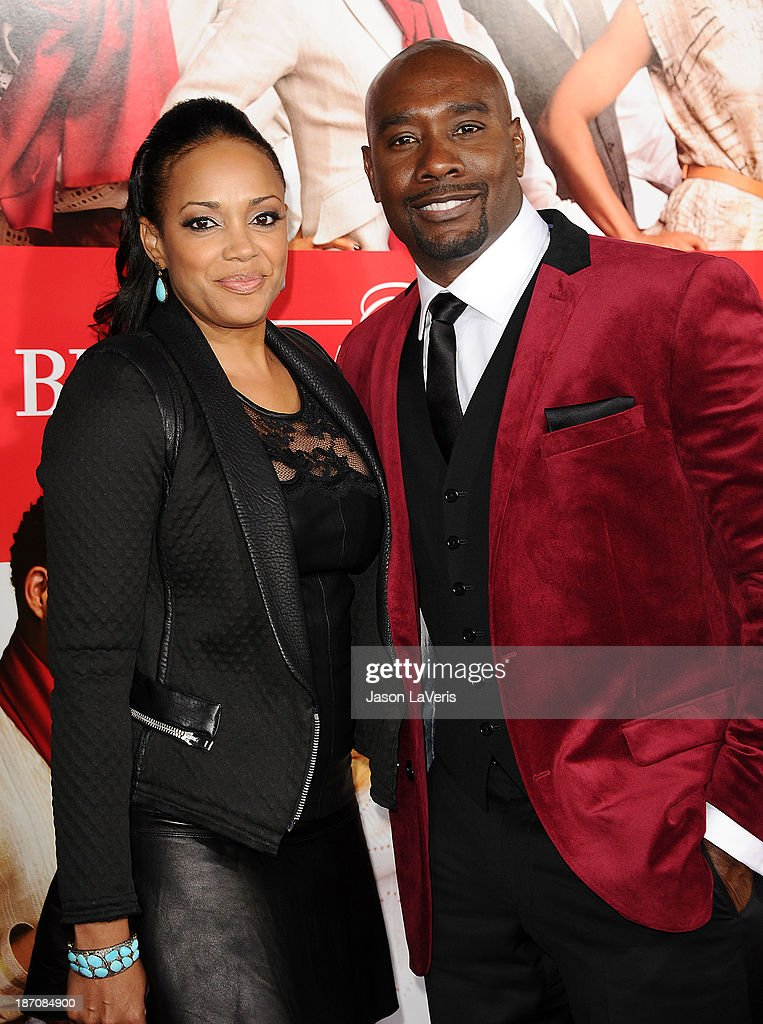 Actor Morris Chestnut (R) and wife Pam Byse attend the premiere of 'The Best Man Holiday' at TCL Chinese Theatre on November 5, 2013 in Hollywood, California.