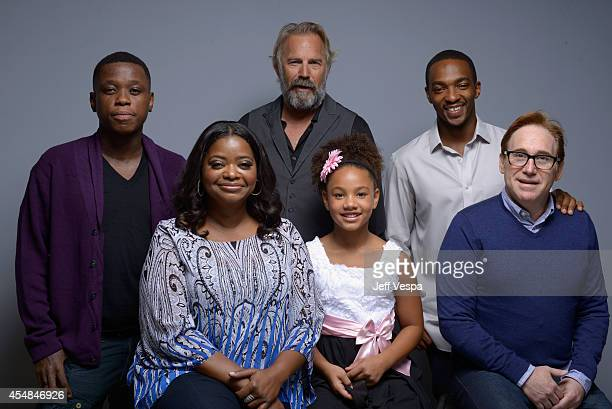 Actor Mpho Koaho actress Octavia Spencer actor Kevin Costner Jillian Estell actor Anthony Mackie and director Mike Binder of 'Black and White' pose...