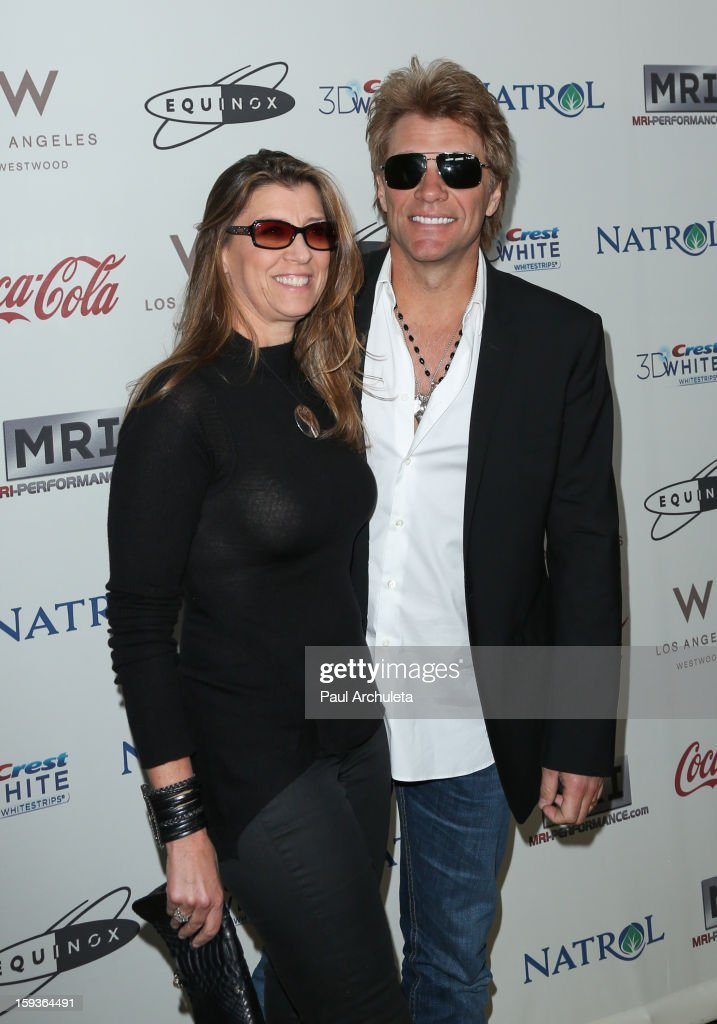 Actor / Musician <a gi-track='captionPersonalityLinkClicked' href=/galleries/search?phrase=Jon+Bon+Jovi&family=editorial&specificpeople=201527 ng-click='$event.stopPropagation()'>Jon Bon Jovi</a> (R) and his wife Dorothea Hurley (L) attend the 'Gold Meets Golden' event on January 12, 2013 in Los Angeles, California.