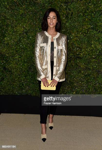 Actor Naomi Scott attends the celebration of Chanel's Gabrielle Bag hosted by Caroline De Maigret and Pharrell Williams at Giorgio Baldi on April 6...