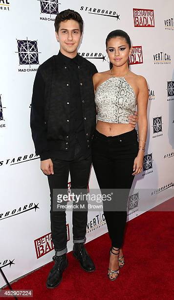 Actor Nat Wolff and actress Selena Gomez attend the Premiere of 'Behaving Badly' at the ArcLight Hollywood on July 29 2014 in Hollywood California