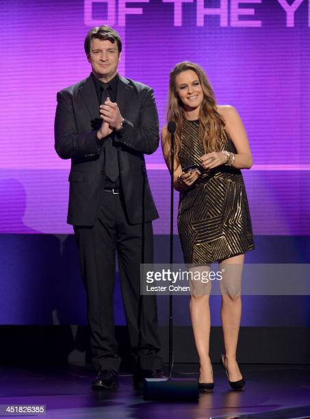 Actor Nathan Fillion and actress Alicia Silverstone speak onstage during the 2013 American Music Awards at Nokia Theatre LA Live on November 24 2013...