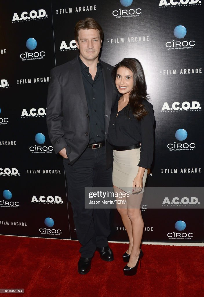 Actor <a gi-track='captionPersonalityLinkClicked' href=/galleries/search?phrase=Nathan+Fillion&family=editorial&specificpeople=834463 ng-click='$event.stopPropagation()'>Nathan Fillion</a> (L) and actress <a gi-track='captionPersonalityLinkClicked' href=/galleries/search?phrase=Mikaela+Hoover&family=editorial&specificpeople=5540251 ng-click='$event.stopPropagation()'>Mikaela Hoover</a> attend the premiere of The Film Arcade's 'A.C.O.D.' at the Landmark Theater on September 26, 2013 in Los Angeles, California.