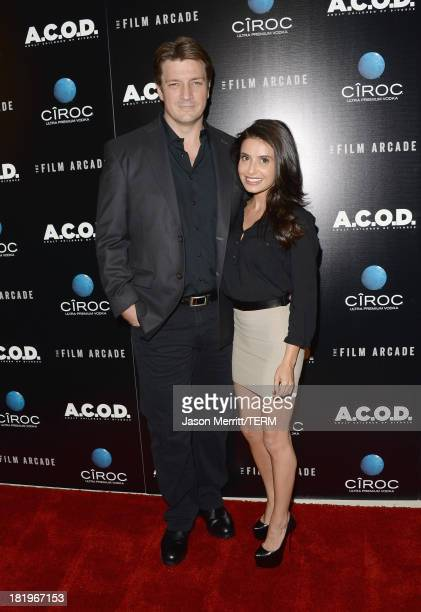 Actor Nathan Fillion and actress Mikaela Hoover attend the premiere of The Film Arcade's 'ACOD' at the Landmark Theater on September 26 2013 in Los...