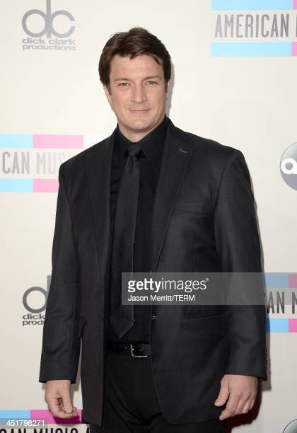 Actor Nathan Fillion attends the 2013 American Music Awards at Nokia Theatre LA Live on November 24 2013 in Los Angeles California