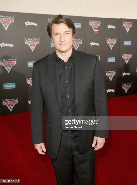 "Actor Nathan Fillion poses at the World Premiere of Disney/Pixar's ""Cars 3' at the Anaheim Convention Center on June 10 2017 in Anaheim California"