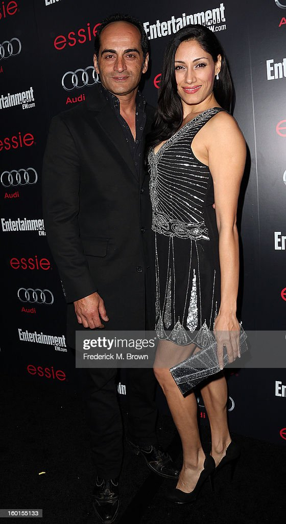 Actor Navid Negahban (L) and actress Tehmina Sunny attend Entertainment Weekly Screen Actors Guild Awards Pre-Party at Chateau Marmont on January 26, 2013 in Los Angeles, California.