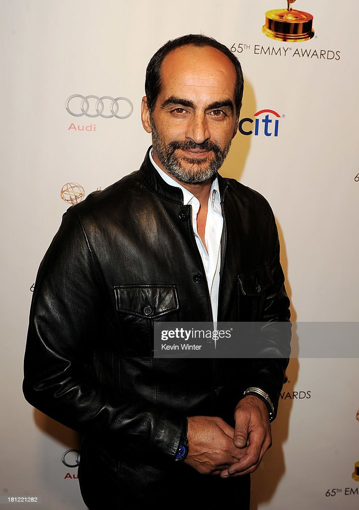 Actor Navid Neghaban arrives at the 65th Primetime Emmy Awards Writer Nominees reception at the Academy of Television Arts & Sciences on September 19, 2013 in No. Hollywood, California.