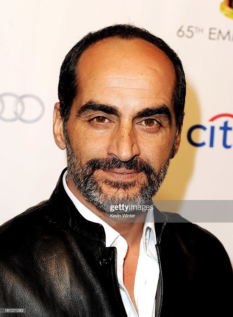 : Actor Navid Neghaban arrives at the 65th Primetime Emmy Awards Writer Nominees reception at the Academy of Television Arts & Sciences on September 19, 2013 in No. Hollywood, California.
