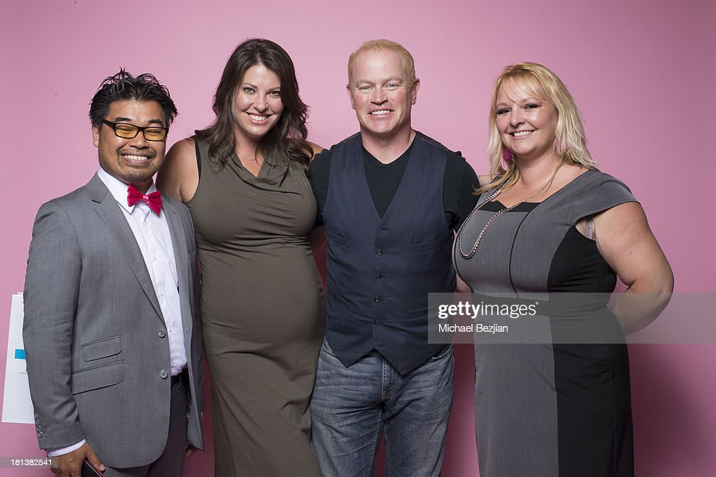 Actor Neal McDonough (C) and wife Ruve McDonough pose for a portrait at the Mark Kearney Group - 'Iced Out' Luxury Emmy Suite on September 20, 2013 in Los Angeles, California.