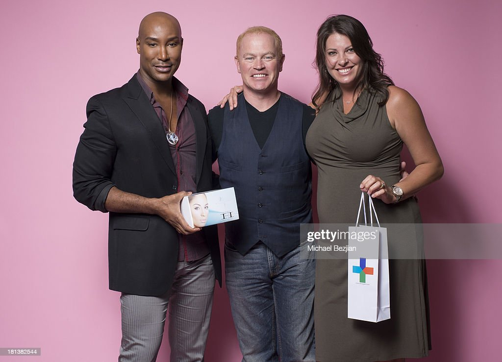 Actor Neal McDonough (C) and wife Ruve McDonough recieve gifts from Marc Harvey's 'Element 2 Beauty' system and Sherrie Berry's 'Skin Again' at the Mark Kearney Group - 'Iced Out' Luxury Emmy Suite on September 20, 2013 in Los Angeles, California.