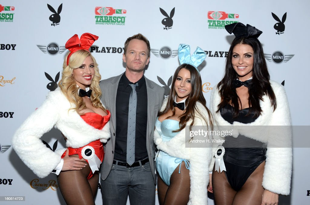 Actor Neil Patrick Harris poses with Playboy Playmates at The Playboy Party Presented by Crown Royal on February 1, 2013 in New Orleans, Louisiana.