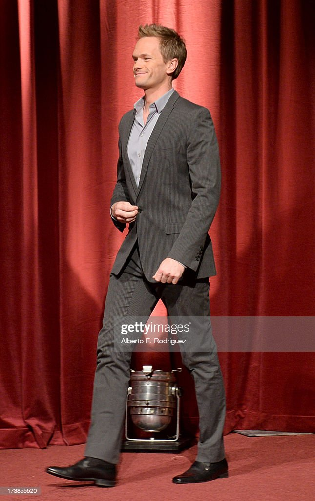 Actor Neil Patrick Harris walks onstage at the 65th Primetime Emmy Awards nominations at the Television Academy's Leonard H. Goldenson Theatre on July 18, 2013 in North Hollywood, California.