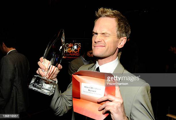 Actor Neil Patrick Harris with the award for 'Favorite Network TV Comedy' attends the 2012 People's Choice Awards at Nokia Theatre LA Live on January...