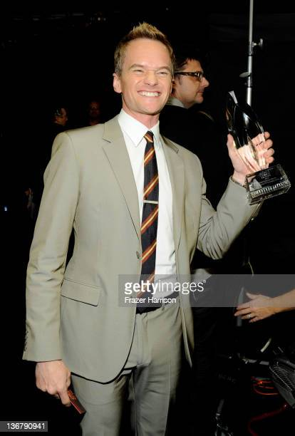 Actor Neil Patrick Harris with the award for 'Favorite TV Comedy Actor' attends the 2012 People's Choice Awards at Nokia Theatre LA Live on January...