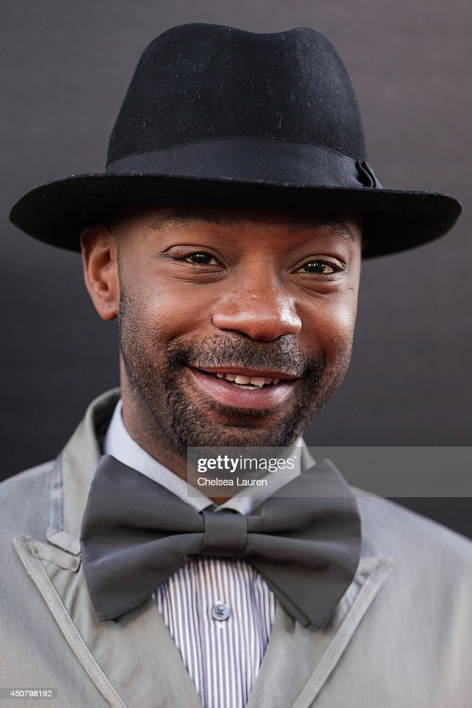 Actor Nelsan Ellis arrives at HBO's 'True Blood' final season premiere at TCL Chinese Theatre on June 17 2014 in Hollywood California