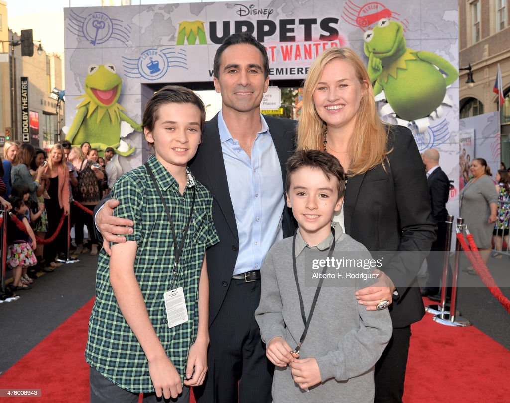 Actor <a gi-track='captionPersonalityLinkClicked' href=/galleries/search?phrase=Nestor+Carbonell&family=editorial&specificpeople=683517 ng-click='$event.stopPropagation()'>Nestor Carbonell</a> and family arrive at the world premiere of Disney's 'Muppets Most Wanted' at the El Capitan Theatre on March 11, 2014 in Hollywood, California.