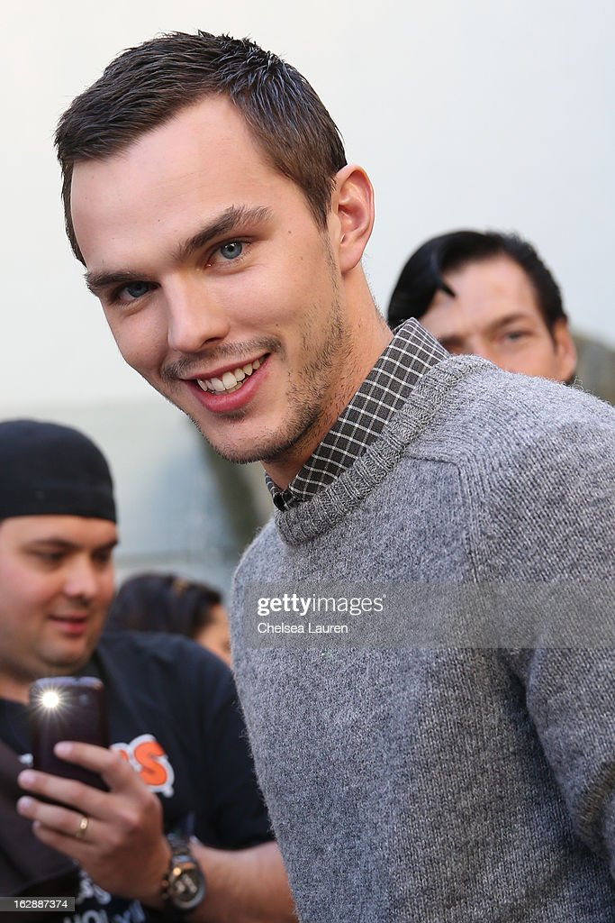 Actor <a gi-track='captionPersonalityLinkClicked' href=/galleries/search?phrase=Nicholas+Hoult&family=editorial&specificpeople=598892 ng-click='$event.stopPropagation()'>Nicholas Hoult</a> greets fans at the unveiling of a giant footprint for 'Jack the Giant Slayer' at TCL Chinese Theatre on February 28, 2013 in Hollywood, California.