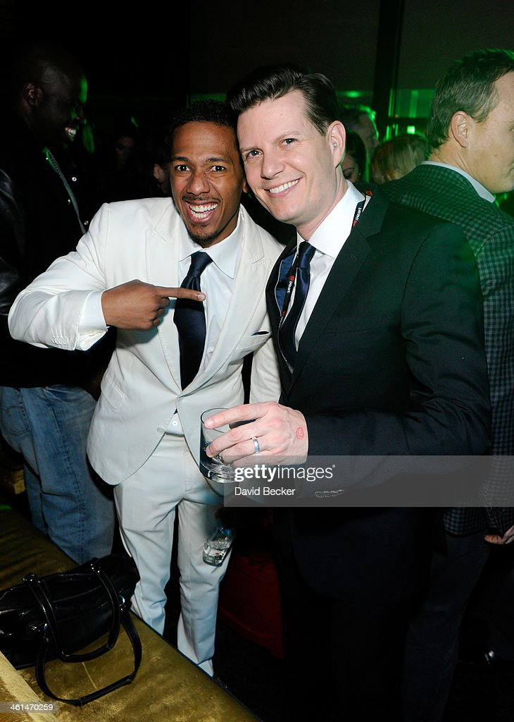 Actor Nick Cannon and Chris Williams, Senior Vice President of iHeartRadio Programming attend a private party celebrating CES 2014 hosted by iHeartRadio featuring a live performance by Krewella at Haze Nightclub at the Aria Resort & Casino at CityCenter on January 8, 2014 in Las Vegas, Nevada.