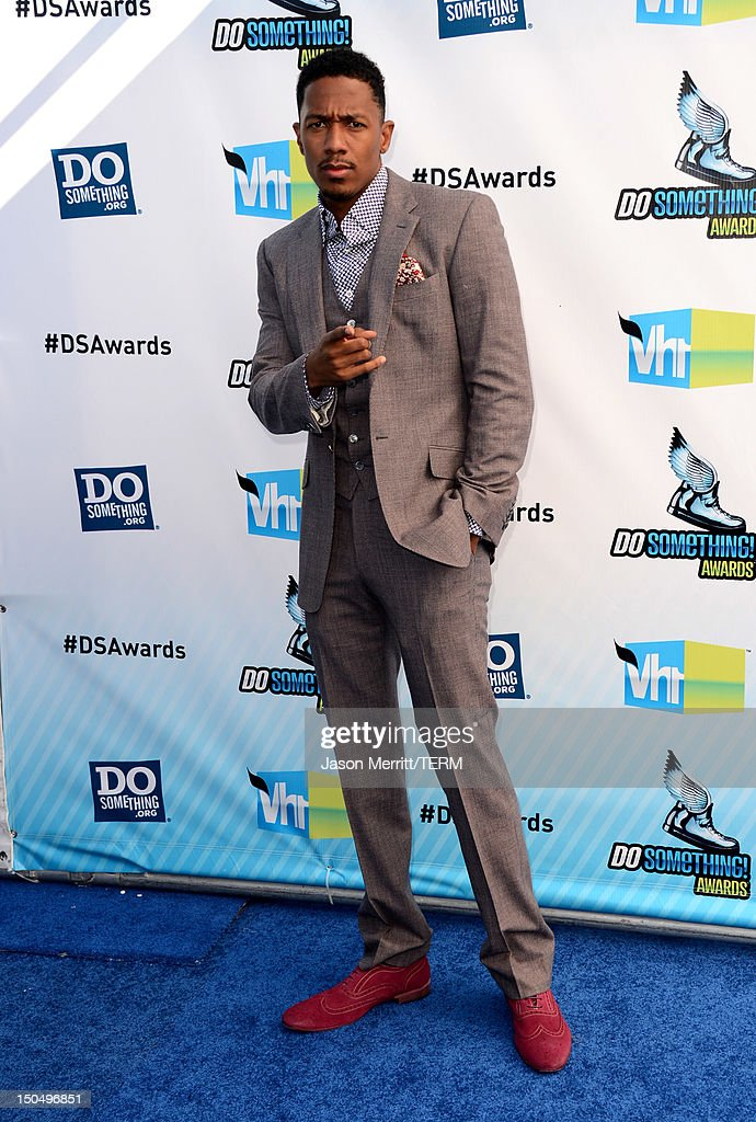 Actor <a gi-track='captionPersonalityLinkClicked' href=/galleries/search?phrase=Nick+Cannon&family=editorial&specificpeople=202208 ng-click='$event.stopPropagation()'>Nick Cannon</a> arrives at the 2012 Do Something Awards at Barker Hangar on August 19, 2012 in Santa Monica, California.