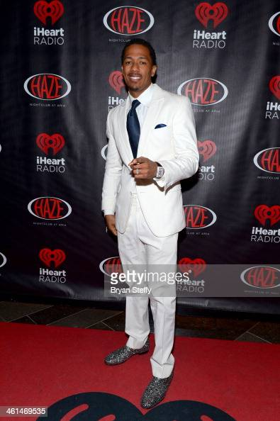 Actor Nick Cannon attends a private party celebrating CES 2014 hosted by iHeartRadio featuring a live performance by Krewella at Haze Nightclub at...