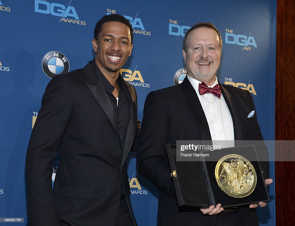 Actor Nick Cannon flanks director Neil P DeGroot as he holds his trophy for Outstanding Directorial Achievement in Reality Programs '72 Hours The...