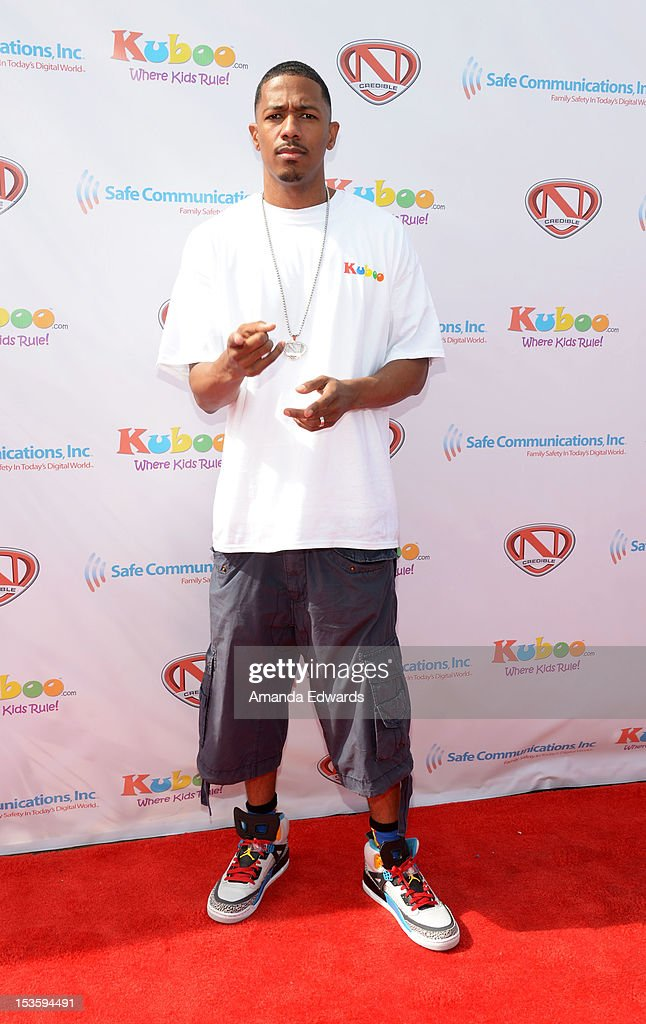 Actor <a gi-track='captionPersonalityLinkClicked' href=/galleries/search?phrase=Nick+Cannon&family=editorial&specificpeople=202208 ng-click='$event.stopPropagation()'>Nick Cannon</a> hosts 'Family Day' at Santa Monica Pier on October 6, 2012 in Santa Monica, California.