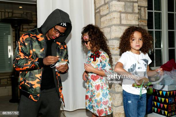 Actor Nick Cannon Monroe Cannon and Moroccan Scott Cannon attend the Moroccan Scott Cannon and Monroe Cannon Party on Mary 13 in Los Angeles...