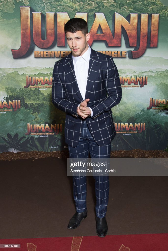 Actor Nick Jonas attends the 'Jumanji': Welcome to the Jungle -Jumanji : Bienvenue dans la jungle-' Paris Premiere at Le Grand Rex on December 5, 2017 in Paris, France.