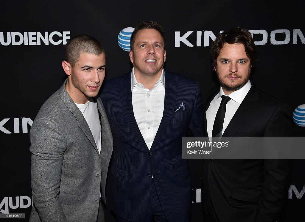 Actor Nick Jonas, Chris Long, Senior Vice President, Original Content and Production, AT&T, and creator/EP Byron Balasco attend the premiere of DIRECTV's 'Kingdom' Season 2 at SilverScreen Theater at the Pacific Design Center on October 6, 2015 in West Hollywood, California.