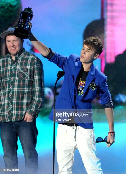 Actor Nick Swardson and singer Justin Bieber speaks onstage during the 2011 MTV Movie Awards at Universal Studios' Gibson Amphitheatre on June 5 2011...