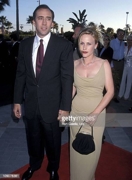 Actor Nicolas Cage and actress Patricia Arquette attend the 'Snake Eyes' Hollywood Premiere on July 30 1998 at Paramount Studios in Hollywood...