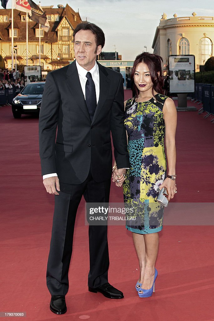 US actor Nicolas Cage and Alice Kim pose before the screening of 'Joe' at the 39th Deauville American Film Festival on September 2, 2013 in the French northwestern sea resort of Deauville.