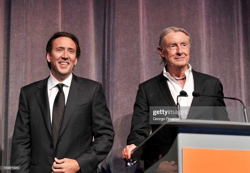 Actor Nicolas Cage and director Joel Schumacher speak onstage at 'Trespass' Premiere at Roy Thomson Hall during the2011 Toronto International Film...