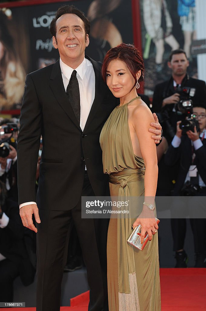 Actor Nicolas Cage and his wife Alice Kim attend 'Joe' Premiere during The 70th Venice International Film Festival at Sala Grande on August 30, 2013 in Venice, Italy.