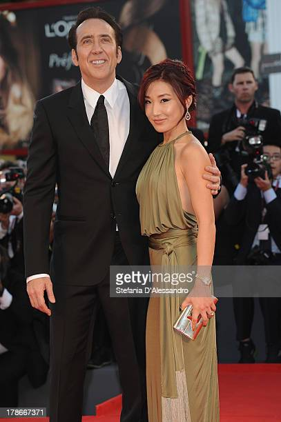 Actor Nicolas Cage and his wife Alice Kim attend 'Joe' Premiere during The 70th Venice International Film Festival at Sala Grande on August 30 2013...