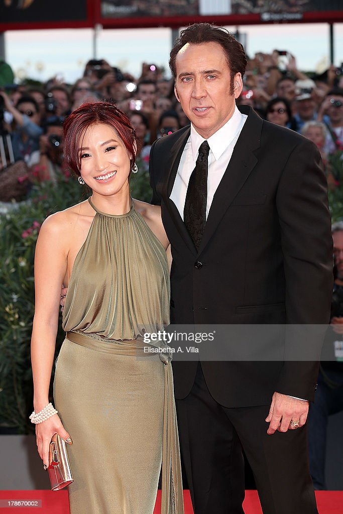 Actor <a gi-track='captionPersonalityLinkClicked' href=/galleries/search?phrase=Nicolas+Cage&family=editorial&specificpeople=196531 ng-click='$event.stopPropagation()'>Nicolas Cage</a> and his wife <a gi-track='captionPersonalityLinkClicked' href=/galleries/search?phrase=Alice+Kim&family=editorial&specificpeople=212731 ng-click='$event.stopPropagation()'>Alice Kim</a> attend 'Joe' Premiere during The 70th Venice International Film Festival at Sala Grande on August 30, 2013 in Venice, Italy.