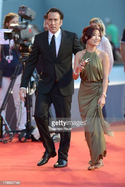 Actor Nicolas Cage and his wife Alice Kim attend 'Joe' Premiere during The 70th Venice International Film Festival at Palazzo del Cinema on August 30...