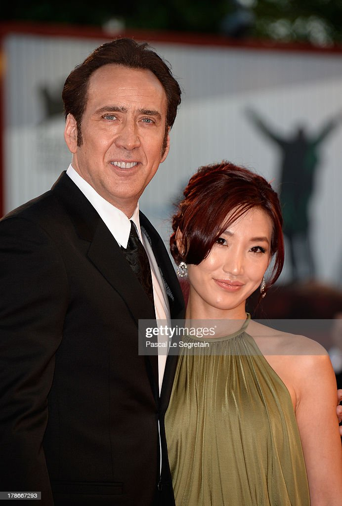 Actor <a gi-track='captionPersonalityLinkClicked' href=/galleries/search?phrase=Nicolas+Cage&family=editorial&specificpeople=196531 ng-click='$event.stopPropagation()'>Nicolas Cage</a> and his wife <a gi-track='captionPersonalityLinkClicked' href=/galleries/search?phrase=Alice+Kim&family=editorial&specificpeople=212731 ng-click='$event.stopPropagation()'>Alice Kim</a> Cage attend the 'Joe' Premiere during The 70th Venice International Film Festival at Palazzo Del Cinema on August 30, 2013 in Venice, Italy.
