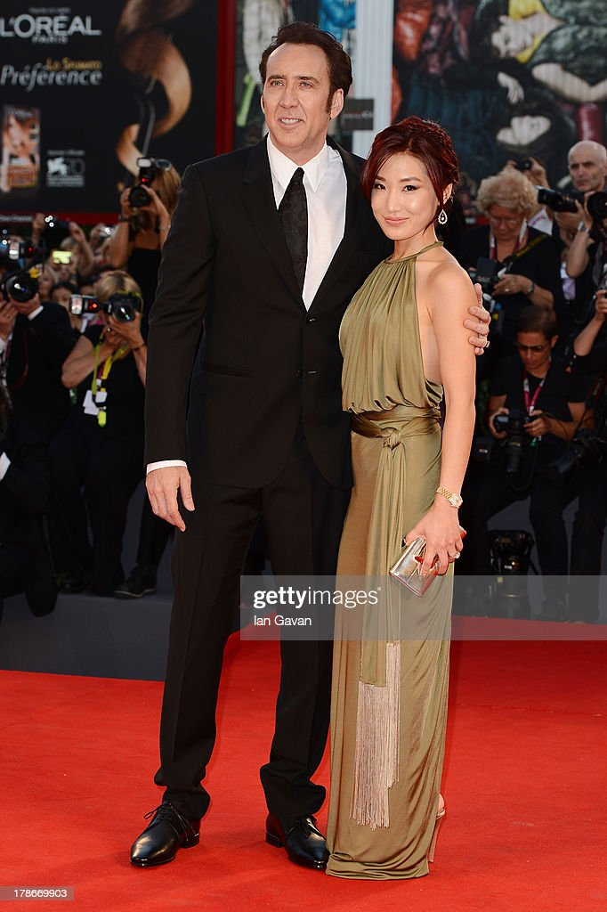 Actor Nicolas Cage and his wife Alice Kim Cage attend the 'Joe' Premiere during The 70th Venice International Film Festival at Palazzo Del Cinema on August 30, 2013 in Venice, Italy.