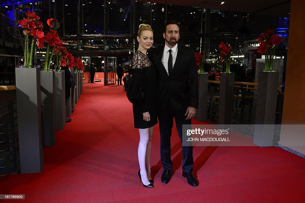 US actor Nicolas Cage and US actress Emma Stone pose for photographers on the red carpet as they arrive prior to the screening of the film 'The Croods' presented out of competition of the 63rd Berlin International Film Festival in Berlin on February 15, 2013.