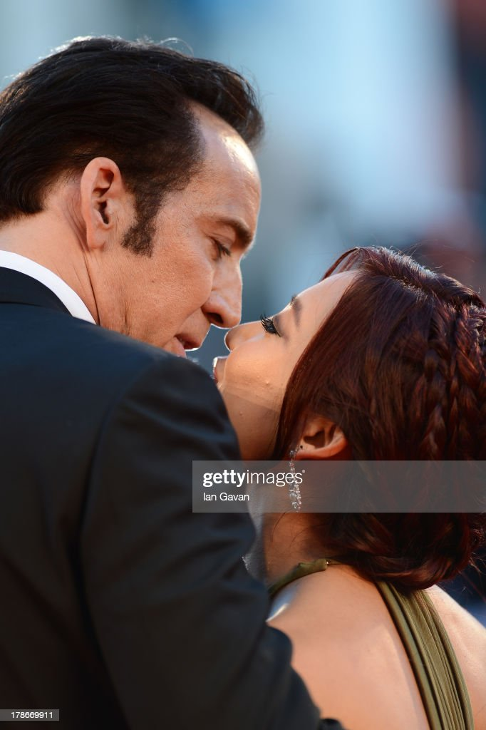 Actor Nicolas Cage kisses his wife Alice Kim Cage at the 'Joe' Premiere during The 70th Venice International Film Festival at Palazzo Del Cinema on August 30, 2013 in Venice, Italy.