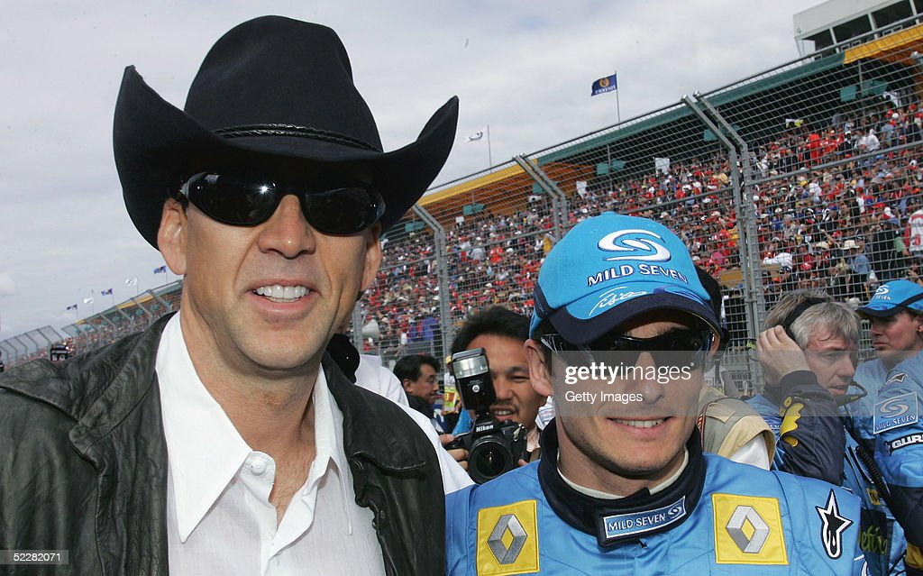 Actor Nicolas Cage with Renault driver Giancarlo Fisichella on the grid prior to the Australian Formula One Grand Prix at Albert Park on March 6, 2005 in Melbourne, Australia.