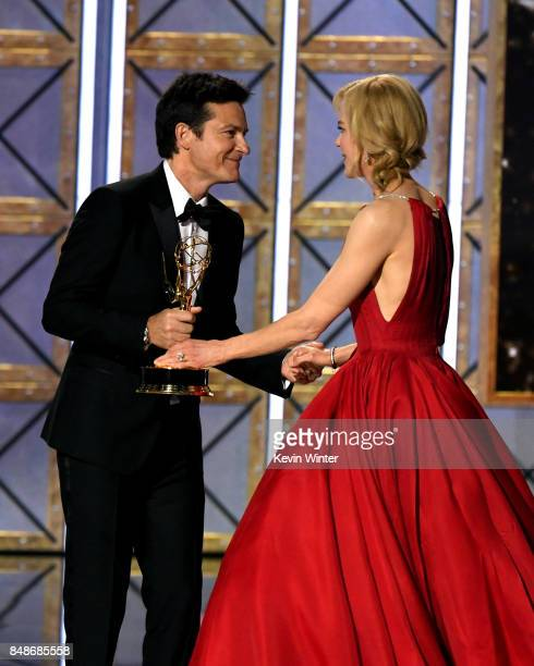Actor Nicole Kidman accepts Outstanding Lead Actress in a Limited Series or Movie for 'Big Little Lies' from actor Jason Bateman onstage during the...